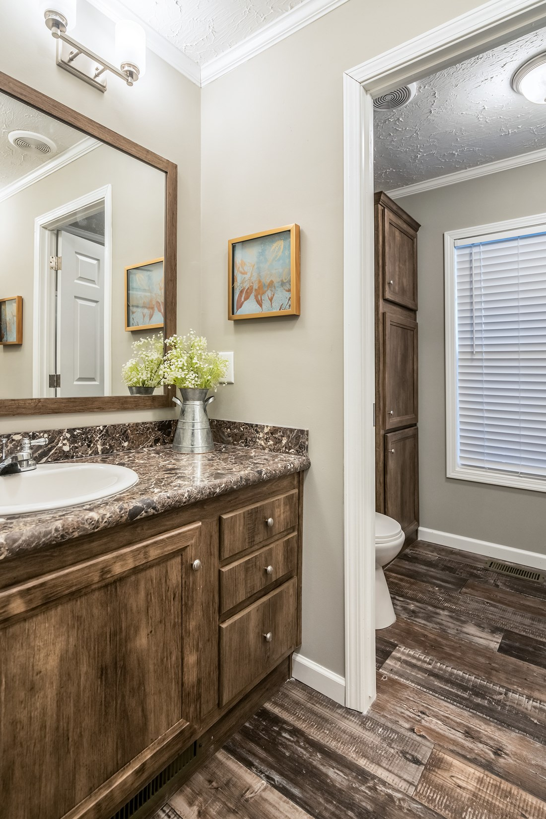 The 5607 ENTERPRISE 7228 Guest Bathroom. This Manufactured Mobile Home features 4 bedrooms and 2 baths.