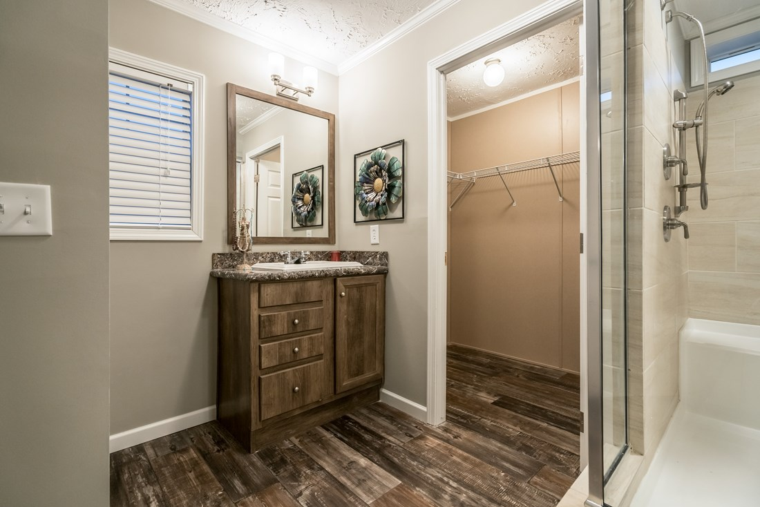 The 5607 ENTERPRISE 7228 Master Bathroom. This Manufactured Mobile Home features 4 bedrooms and 2 baths.