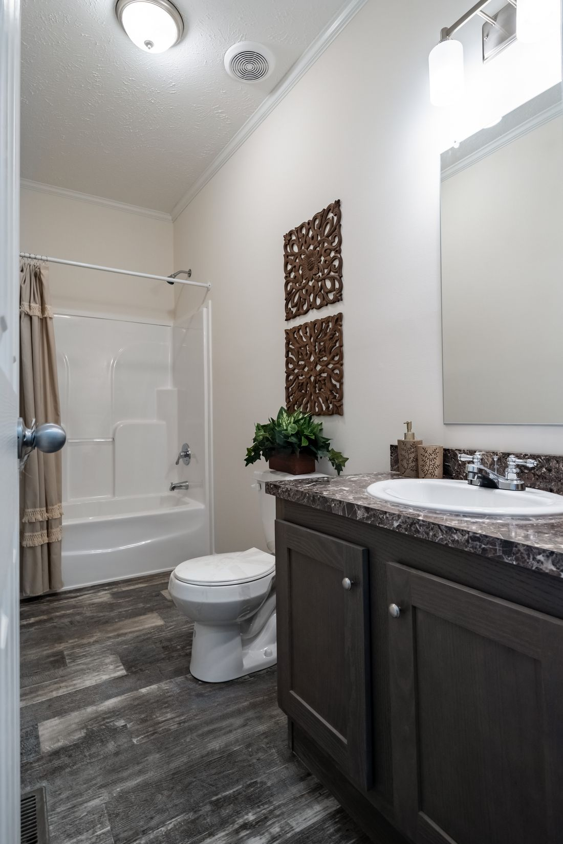 The 4058 ELITE PLUS 6216 Guest Bathroom. This Manufactured Mobile Home features 2 bedrooms and 2 baths.
