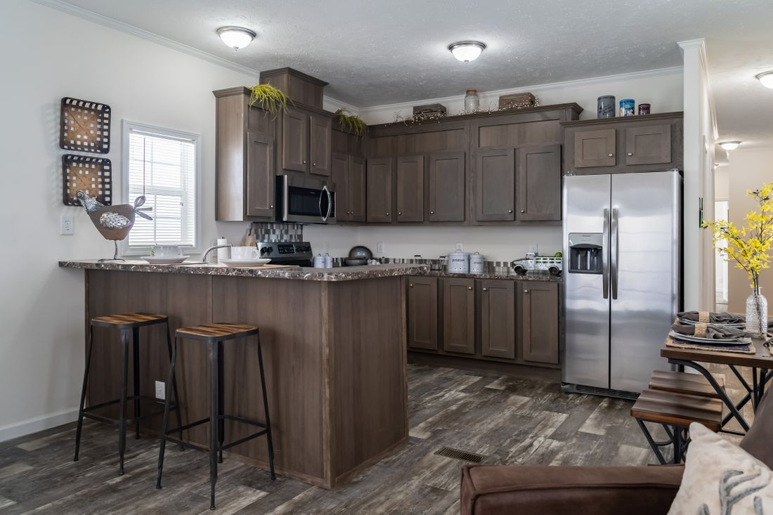The 4058 ELITE PLUS 6216 Kitchen. This Manufactured Mobile Home features 2 bedrooms and 2 baths.