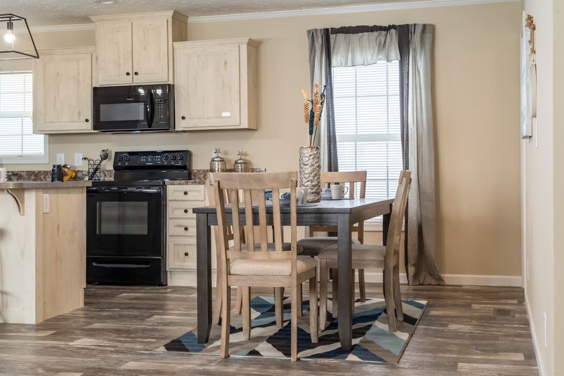 The 7120 ENTERPRISE 4828 Kitchen. This Manufactured Mobile Home features 3 bedrooms and 2 baths.