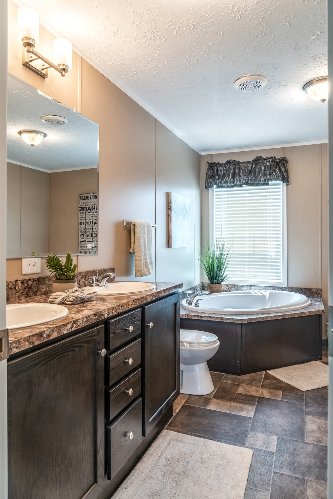 The 5604 ENTERPRISE 4 6428 Master Bathroom. This Manufactured Mobile Home features 3 bedrooms and 2 baths.