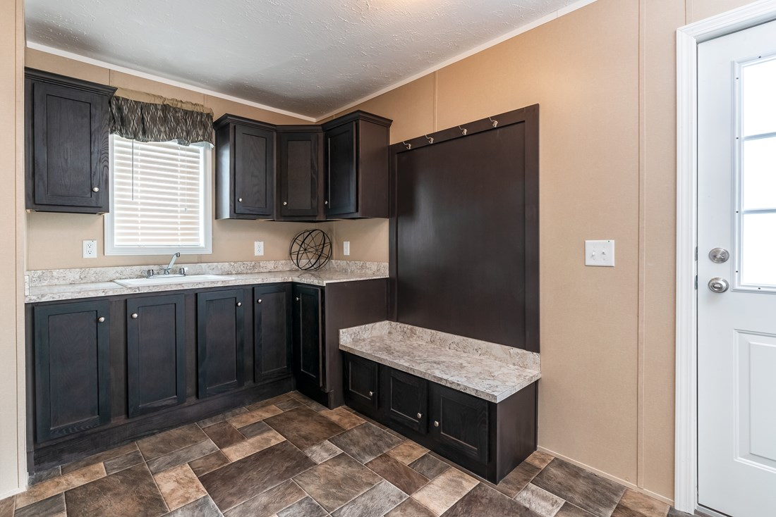 The 5604 ENTERPRISE 4 6428 Utility Room. This Manufactured Mobile Home features 3 bedrooms and 2 baths.