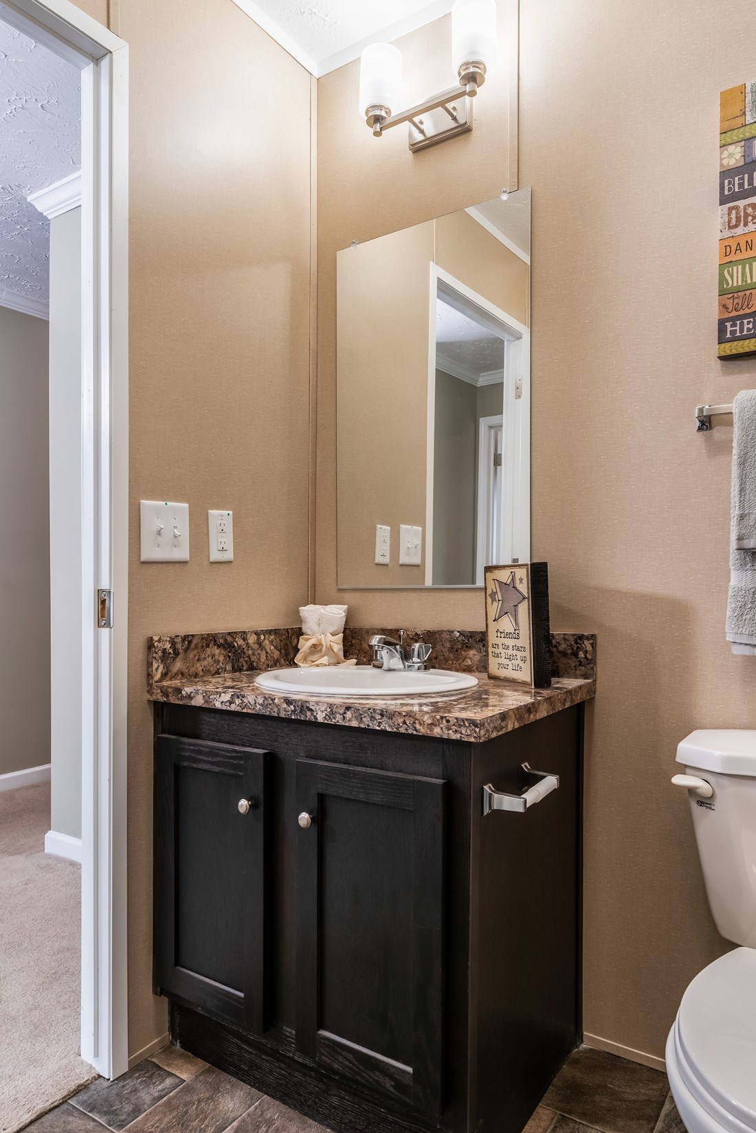 The 5604 ENTERPRISE 4 6428 Guest Bathroom. This Manufactured Mobile Home features 3 bedrooms and 2 baths.