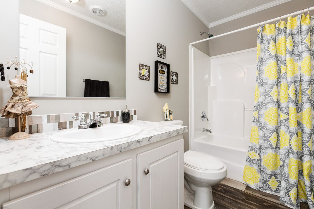 The 5602 ENTERPRISE 2 7028 Guest Bathroom. This Manufactured Mobile Home features 4 bedrooms and 2 baths.